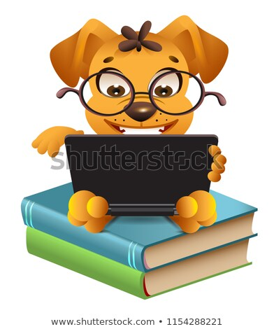 funny yellow dog sitting on books and reading laptop stock photo © orensila