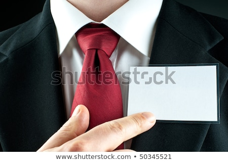 Businessman points at a name badge id Stock photo © studiostoks