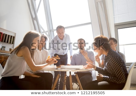 happy business team eating pizza at office stock photo © dolgachov