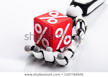 Robot Holding Cubic Block With Percentage Sign Stock photo © AndreyPopov