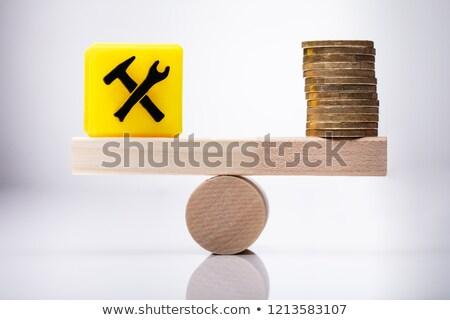 építkezés ikon érmék egyensúlyoz hinta citromsárga Stock fotó © AndreyPopov