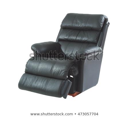 A studio shot of a leather black armchair isolated on white back Stock photo © konradbak