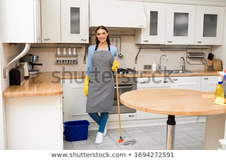 Female cleaner with broom and bucket Stock photo © colematt