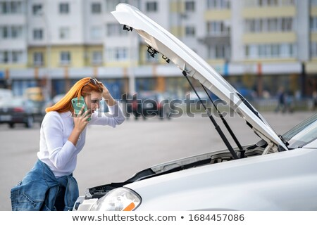woman calling on cellphone near break down car stock photo © andreypopov