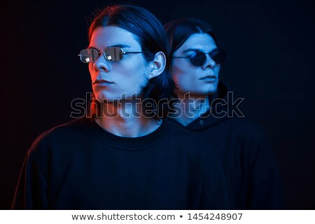 Retrato dois jovem atraente gêmeo irmãos Foto stock © deandrobot