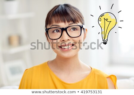 asian woman in glasses with light bulb doodle stock photo © dolgachov