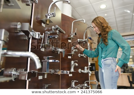 woman looking at white sink pipe in hands stock photo © andreypopov