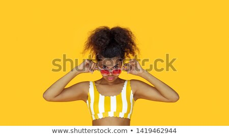 Photo of young woman 20s wearing casual clothes holding black la Stock photo © deandrobot