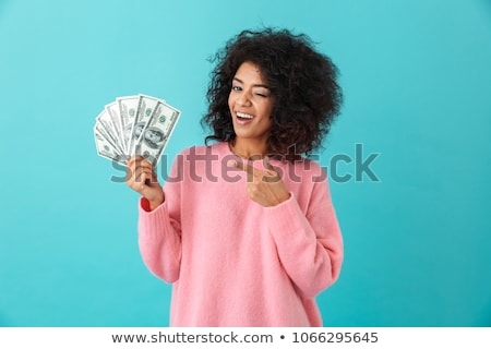 image of successful woman 20s with curly hair holding fan of dol stock photo © deandrobot