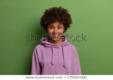 Portrait of a happy young woman wearing hoodie Stock photo © deandrobot