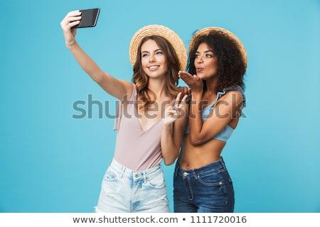 Foto opgewonden amerikaanse vrouw 20s Stockfoto © deandrobot