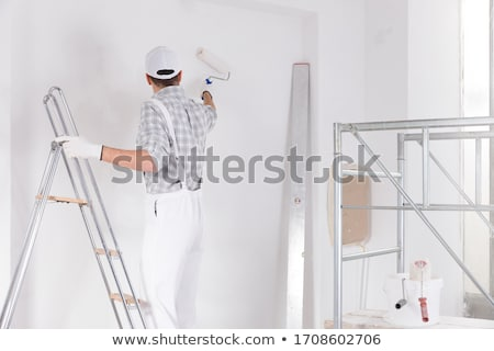 Painter working on a wall Photo stock © Kzenon