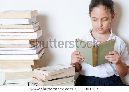 női · diák · egyenruha · ül · köteg · könyvek - stock fotó © monkey_business