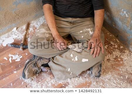 Mason man having a rest after removing paint Stock photo © lunamarina