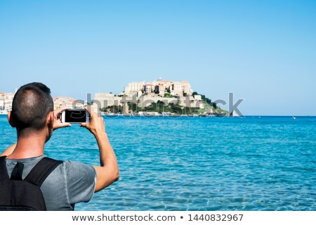 man taking a picture of Calvi, in Corsica, France Stock photo © nito