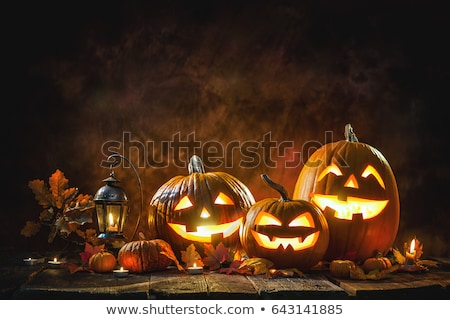 halloween background with a spooky jack o lantern at night stock photo © solarseven