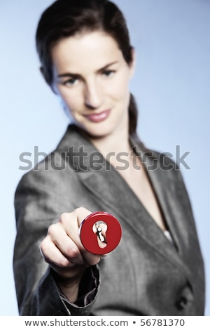 Unlocking opportunities, woman putting key into keyhole Stock photo © lichtmeister