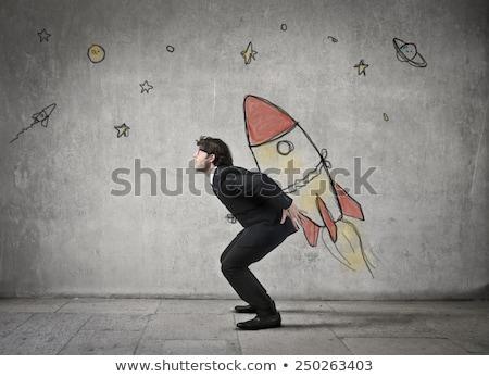 Businessman shooting star. Stock photo © lichtmeister