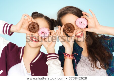 gelukkig · mooie · tienermeisjes · eten · donuts · mensen - stockfoto © dolgachov