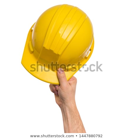 Person's Hand Holding Hard Hat Stock photo © AndreyPopov