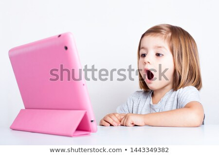 astonished student girl with tablet pc at school Stock photo © dolgachov