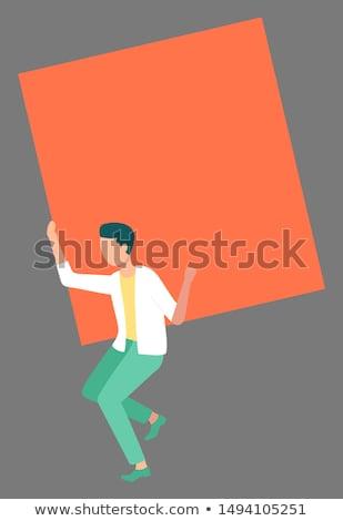 Okos férfi visel világoszöld nadrág narancs Stock fotó © robuart