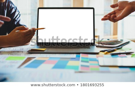 Pointing at desktop stock photo © pressmaster