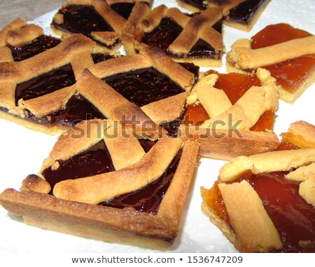 Fresh baked tarts with marmalade filling and apricot jam in glas Stock photo © marylooo