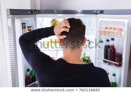 Hungrig verwechselt Mann schauen öffnen Kühlschrank Stock foto © AndreyPopov