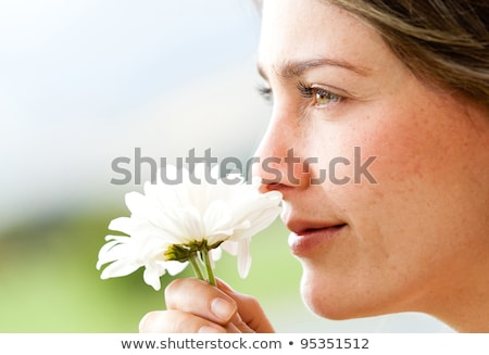Woman smelling white flower Stock photo © adamr