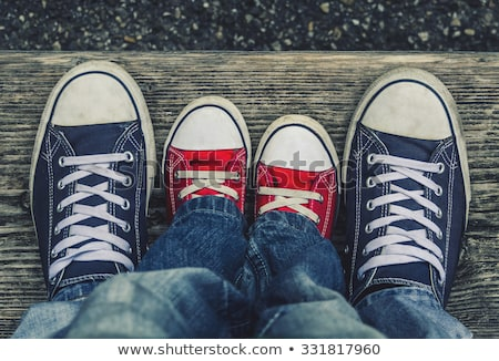 Stock photo: Two jeans sport shoes of a child