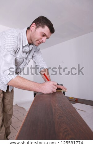 Man marking parquet floor before cutting to size Stock photo © photography33