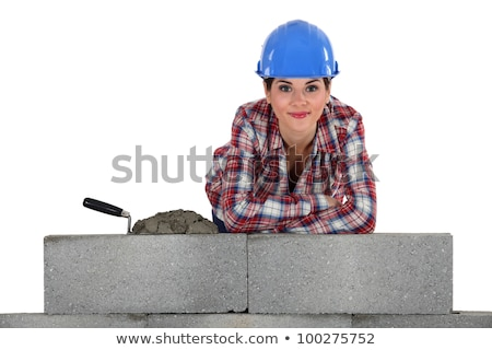 female bricklayer with arms resting on concrete wall Stock photo © photography33