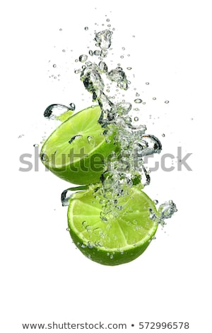 slice of lime in the water with bubbles Stock photo © ozaiachin
