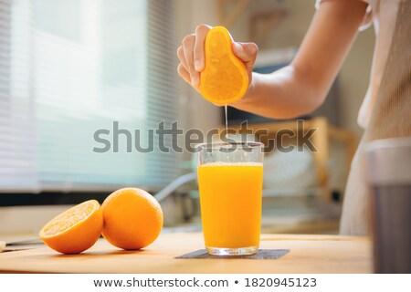 Koktajl pomarańczowy plasterka odznaczony owoców lodu pić Zdjęcia stock © OleksandrO