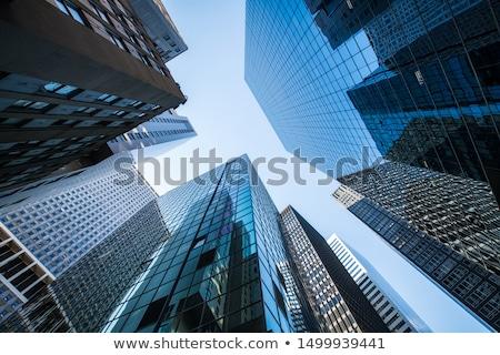 Arranha-céus vidro aço reflexões luz solar céu Foto stock © fixer00
