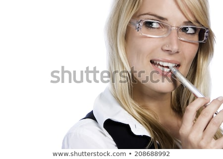 Young woman chewing on a pen Stock photo © photography33