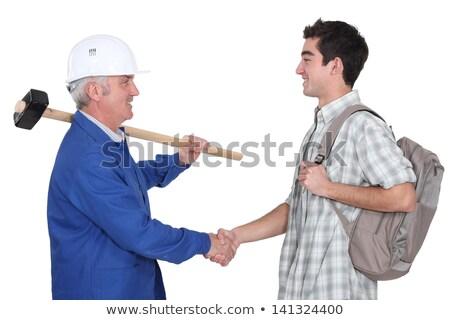 Experiente novo aprendiz homem trabalhar Foto stock © photography33