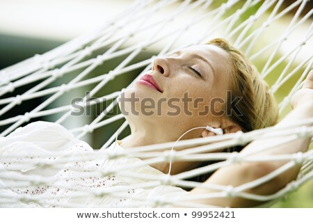 Woman laying in hammock Stock photo © photography33