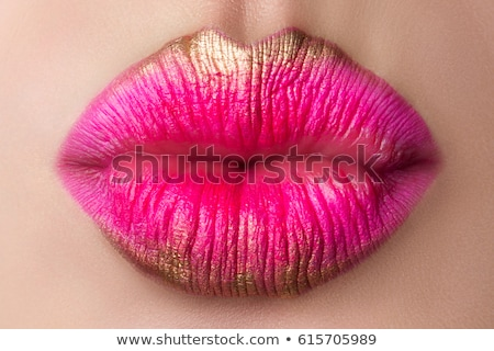 golden lips close up Stock photo © carlodapino