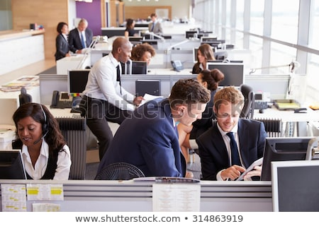two colleagues working in open plan office stock photo © photography33