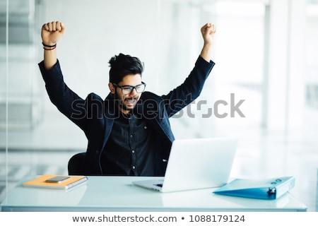 happy businessman punching the air in celebration stock photo © wavebreak_media