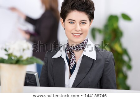 Bella receptionist business donna felice lavoro Foto d'archivio © stockyimages