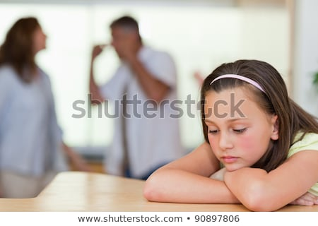 Sad looking girl with her fighting parents behind her stock photo © wavebreak_media