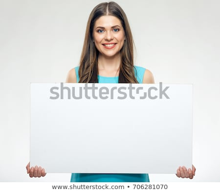 beautiful young woman with long hair holding white board stock photo © nobilior