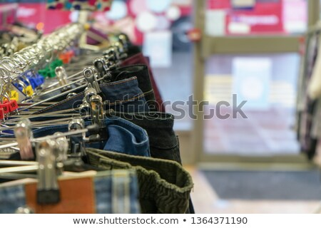 flea market or thrift shop, used jeans on sale stock photo © mtkang