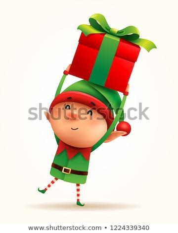Stock photo: Christmas elf with gift