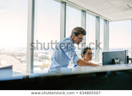 Businessman Pointing at Computer Monitor Stock photo © saje