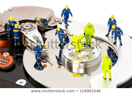 Stockfoto: Group Of Engineers Maintaining Hard Drive