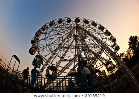 people enjoy the big wheel in the amusement park in delhi in fro stock photo © meinzahn